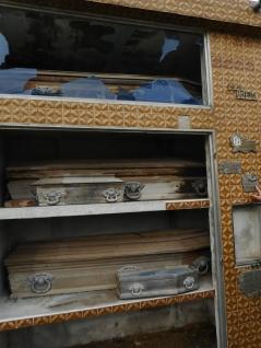 Coffins on shelves